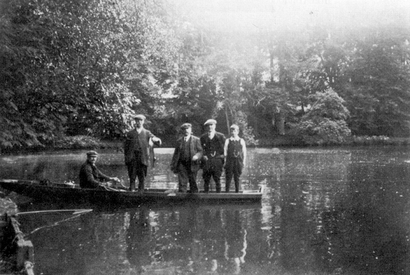 A Fishing Party at the Abbey Lake, 1920s Fishing party, Abbey Lake, early \'20\'s. Mr. T. Taylor holding his catch.
