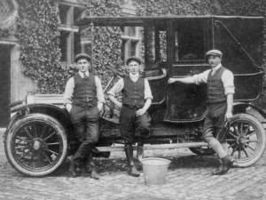 Lord North's Chauffeur, Mr Mines, Stud Groom, Mr. Mansfield, and Groom (unknown). The car is a French